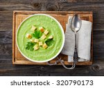 bowl of broccoli and green peas ... | Shutterstock . vector #320790173