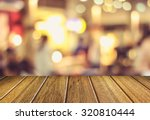 wooden table and blurry beer... | Shutterstock . vector #320810444