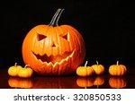 halloween pumpkin and tiny... | Shutterstock . vector #320850533