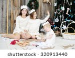 three sisters age of 10 month ... | Shutterstock . vector #320913440