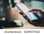 closeup of girl s hand texting... | Shutterstock . vector #320937518