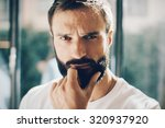 portrait of a young man wearing ... | Shutterstock . vector #320937920