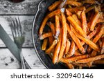 sweet potato fries in cast iron ... | Shutterstock . vector #320940146