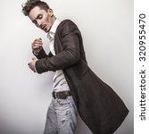 elegant young handsome man in... | Shutterstock . vector #320955470