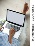 woman working with laptop at... | Shutterstock . vector #320970563