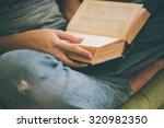 book in hands. reading ... | Shutterstock . vector #320982350