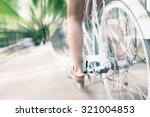 Closeup Of Woman Riding By Blue ...