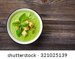 bowl of broccoli and green peas ... | Shutterstock . vector #321025139