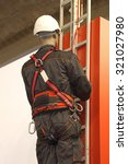 worker on a ladder uses a... | Shutterstock . vector #321027980