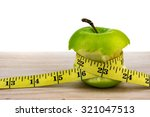 apple wrapped with measuring... | Shutterstock . vector #321047513