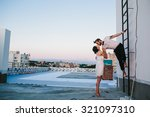 Stock photo beautiful couple together on the roof of a tall building 321097310