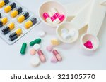 many types of pills on a white... | Shutterstock . vector #321105770