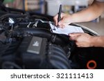 mechanic repairman inspecting... | Shutterstock . vector #321111413