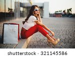 young woman with shopping bags... | Shutterstock . vector #321145586