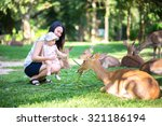 mom and her child in the zoo | Shutterstock . vector #321186194