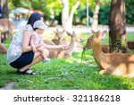 mom and her child in the zoo | Shutterstock . vector #321186218