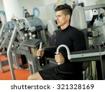 young man training in the gym | Shutterstock . vector #321328169