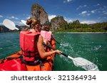 caucasian woman is kayaking in... | Shutterstock . vector #321364934