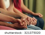 young people holding hands... | Shutterstock . vector #321375020