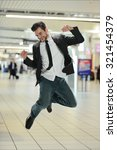 young businessman jumping of... | Shutterstock . vector #321454379