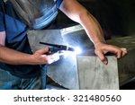 Metalworker Welding Two Metal...