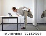 leg exercise during office work ... | Shutterstock . vector #321514019