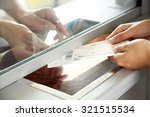 woman buying tickets at box... | Shutterstock . vector #321515534
