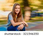 beautiful girl in autumn.... | Shutterstock . vector #321546350