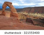delicate arch at sunset in...
