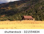 log cabin in the rocky... | Shutterstock . vector #321554834
