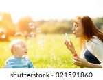 mother and son making soap... | Shutterstock . vector #321591860