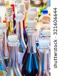 bottles with self made liqueur - stock photo