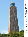 Small photo of The old Cape Henry lighthouse at Fort Story in Virginia Beach, Virginia