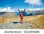 hiker at the top of a pass with ... | Shutterstock . vector #321654680
