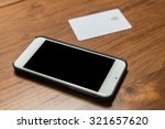 smartphone and blank credit... | Shutterstock . vector #321657620