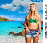 Small photo of Blond tourist girl in Cala Agulla beach of Mallorca photomount