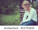 portrait of sad little girl at... | Shutterstock . vector #321753320