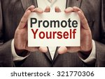businessman holding promote... | Shutterstock . vector #321770306