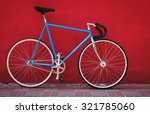 vintage blue bicycle on red... | Shutterstock . vector #321785060