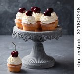 cherry cupcakes on a cake stand ... | Shutterstock . vector #321804248