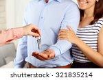 real estate agent giving keys... | Shutterstock . vector #321835214