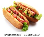 Stock photo a pair of fresh hot dogs isolated on white 321850310