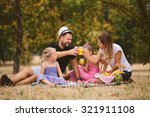 Family At Picnic In The Park