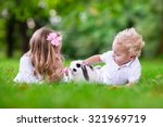 children play with real rabbit. ... | Shutterstock . vector #321969719