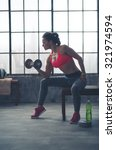 a fit  sporty young woman is... | Shutterstock . vector #321974594