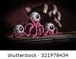 Dark Hand On Top Of Octopus...