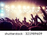 audience with hands raised at a ... | Shutterstock . vector #321989609