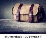 men's brown bag on wooden table ... | Shutterstock . vector #321998654
