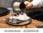 male hand pouring turkish coffee | Shutterstock . vector #322003418