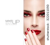 Beauty and Makeup concept. Beautiful fashion model woman with bright make-up. Trendy red lips, nails and smoky eyes. Long eyelashes. High fashion portrait with blank copy space alongside. Sample text - stock photo
